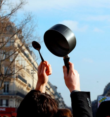 Activists from left-wing parties and other groups beat with spoon on saucepan during a demonstration at the Place de la Republique against corruption in politics, amid a presidential campaign clouded by a fake jobs investigation and other legal scandals, in Paris, Sunday, Feb. 19, 2017. Protesters especially targeted conservative presidential candidate Francois Fillon, under investigation for alleged high-paying but fake parliamentary jobs for his wife and children. (AP Photo/Francois Mori)